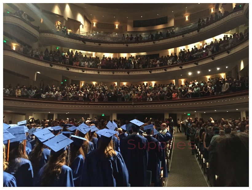 Graduation ceremony in large room with balcony