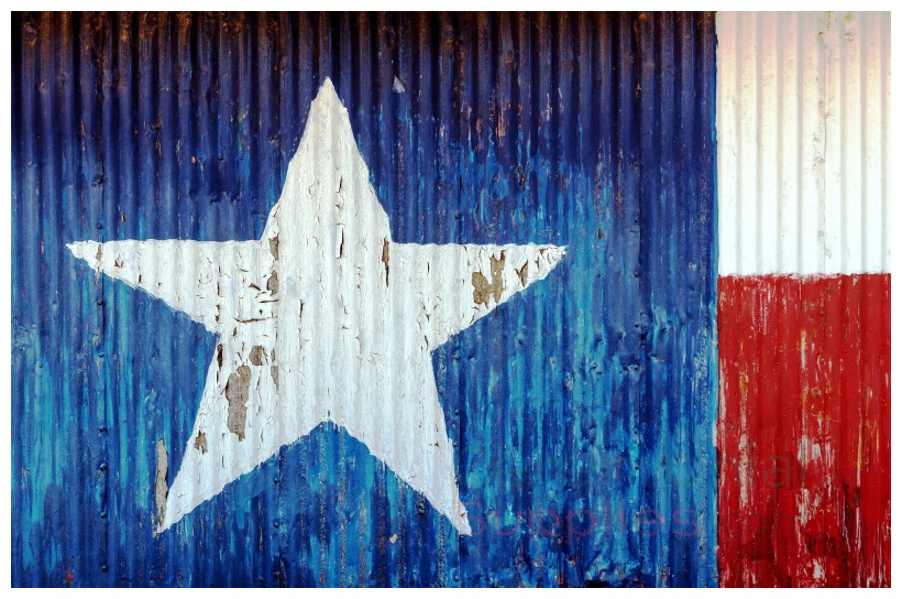 Faded red, white and blue Texas state flag painted on surface.