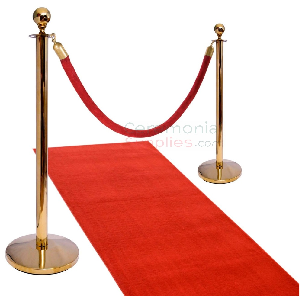 brass stanchions with rope and red carpet