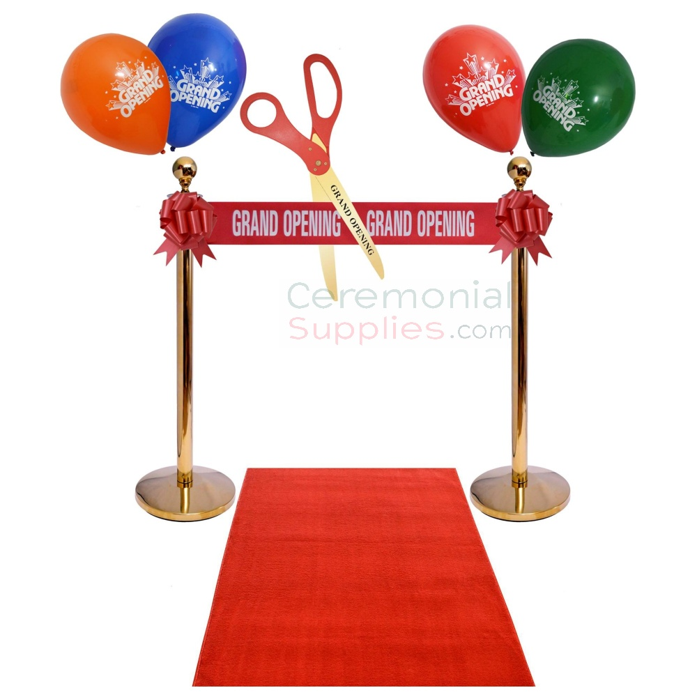 red carpet stanchions scissors and ribbon