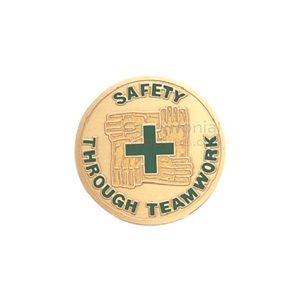 Front view image of the Safety Through Teamwork medal which presents four hands holding each other surrounding a green cross in the center.