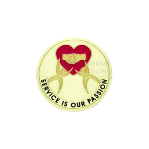 Image of the Service is our Passion medal featuring a red heart with two hands shaking each other in agreement.
