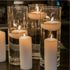 Picture of a Ceremonial Glass Cylinder with a floating candle.