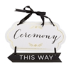 Photo of a Gold Accented Ceremony Guide Sign pointing left.