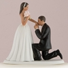 Photo of a medium tone On One Knee Bride and Groom Cake Topper.