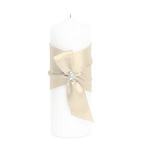 Picture of candle wrapped in an ivory ribbon with a jewel adornment on the center.