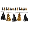 Picture of black and gold festive tasstel garland.