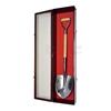 Groundbreaking shovel display case with glass door open.