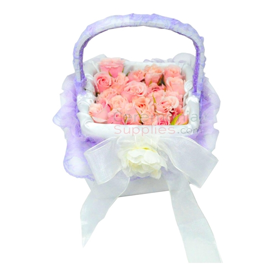 Wedding Flower Girl Basket with flower petals.