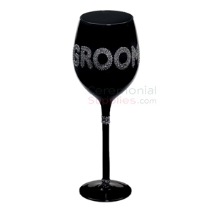 Photo of the Groom wine glasses in decorative embellishments.