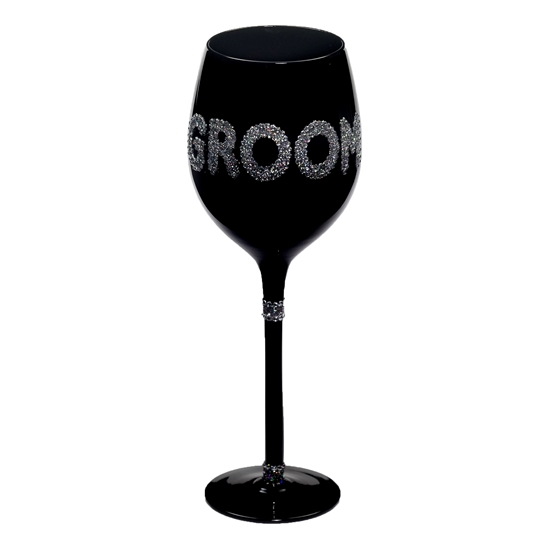Photo of the Groom wine glasses in decorative embellishments.