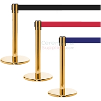 Photo of the luxury brass mini stanchions with black, red, and blue retractable belt.