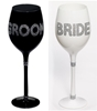 Photo of the Bride and Groom wine glasses in decorative embellishments.