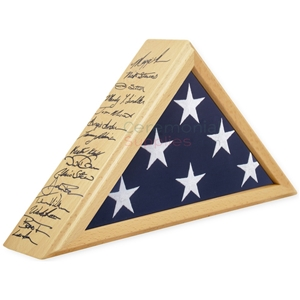 Triangle flag display case with light wood and handwriting on the side