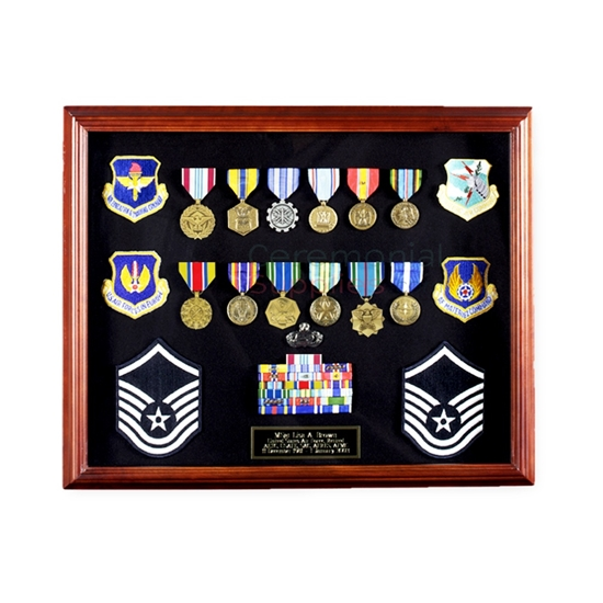 Picture of cherry finish display case full of medals