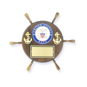 Ship wheel shaped wooden plaque with the US Navy emblem and two anchors, and a plate to engrave below