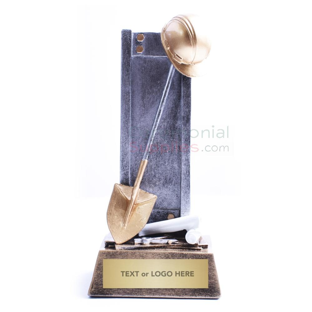 desk trophy of miniature shovel and concrete slab