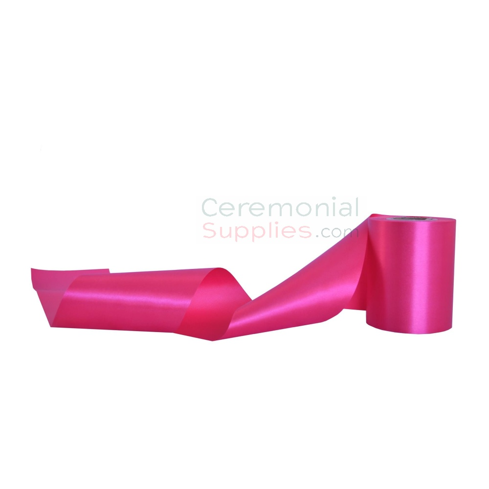 Plain hot pink grand opening ribbon in unrolled and swirly pose.