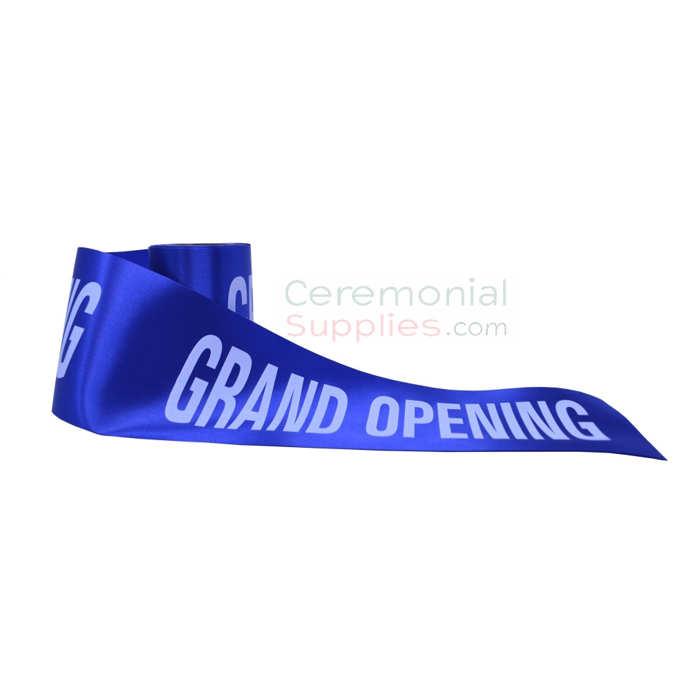 Grand opening ribbon in royal blue showing printed message.