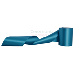 Grand opening ribbon in teal in unraveled swirl pose.