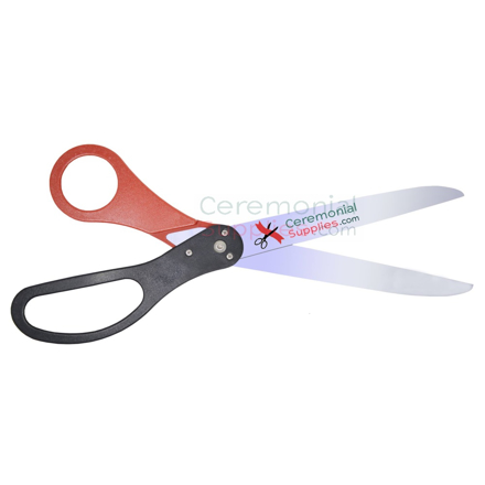 Picture of custom two-tone ribbon cutting scissors in red and black in open position.