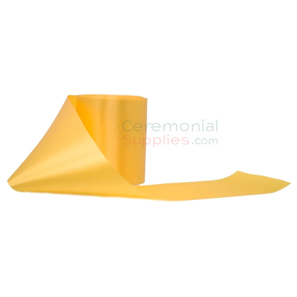 Grand-Opening-Ribbon-In-Yellow-in unrolled pose.