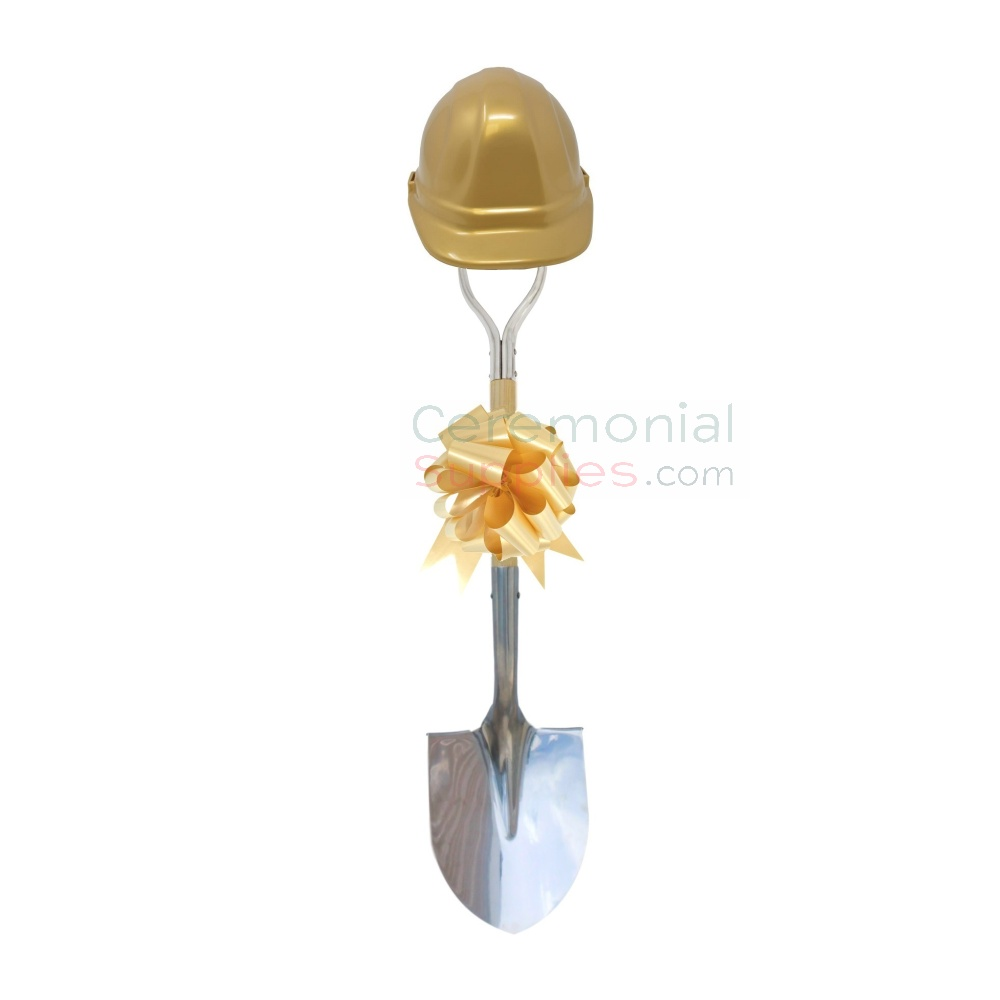 Front View of Golden Groundbreaking Kit with Hard Hat and Bow.