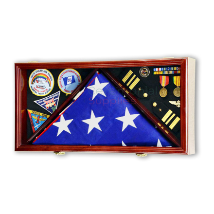 Large rectangle case sectioned off in three rectangles two holding medals and one holding an American flag