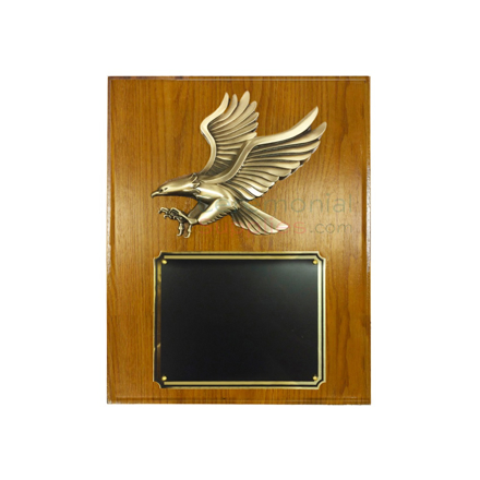 Brass eagle on a wooden plaque with black area for engraving