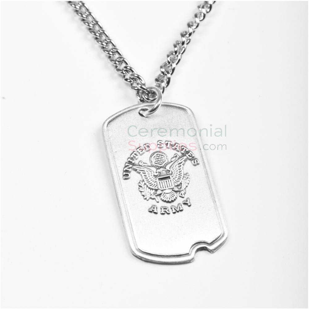 Close up image of US Army symbol on silver Dog Tag